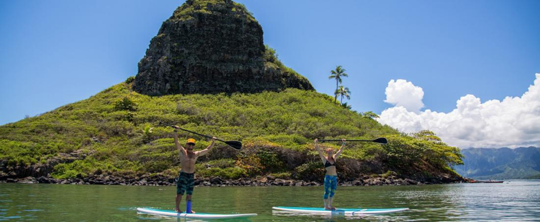 Stand Up Paddle Boarding to secret locations is just one of the things you will do on the Full Day Adventure with Mahina Hawaii