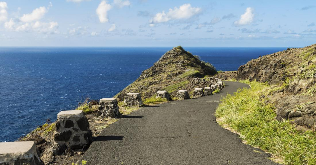 The hiking trail leading down Makapuu Point with an expansive view of the Pacific Ocean